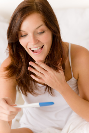 Pregnancy test - happy surprised woman